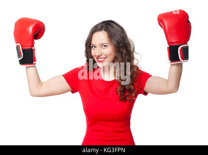 Smiling brunette Mädchen in rot Boxhandschuhe erhobenen Händen bis - Stockfoto