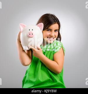 Schöne und glückliche junge Mädchen, dass eine sparschwein - Stockfoto