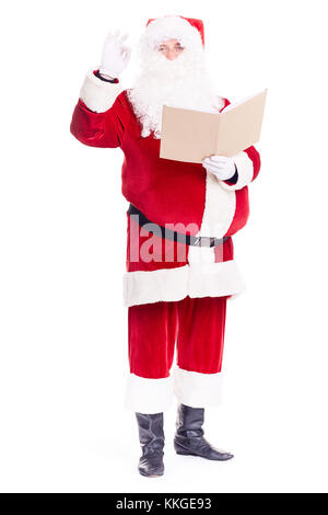 Weihnachtsmann mit Buch - Stockfoto