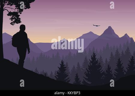 Ein Tourist zu Fuß durch eine Berglandschaft mit einem Wald und einem fliegenden Vogel unter einem Morgen Himmel - Stockfoto