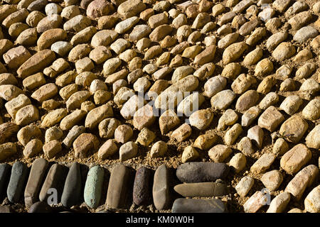 Nahaufnahme der hellen und dunklen Gehweg Pflastersteine, Mexiko - Stockfoto