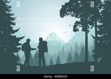 Zwei Touristen zu Fuß durch eine Berglandschaft mit einem Wald auf der Suche nach einem Weg in die Karte unter einem - Stockfoto