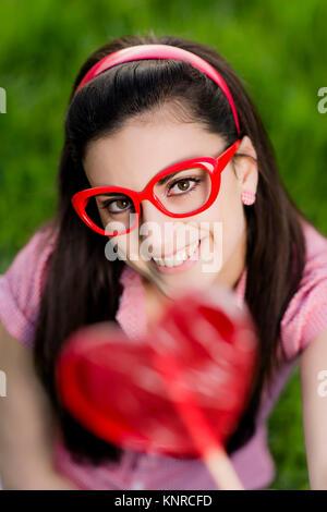 Frau Mit Herzlolly - Frau mit Herz - Stockfoto