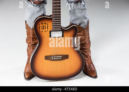 Beine in Jeans und Stiefeln Cowboys - Stockfoto