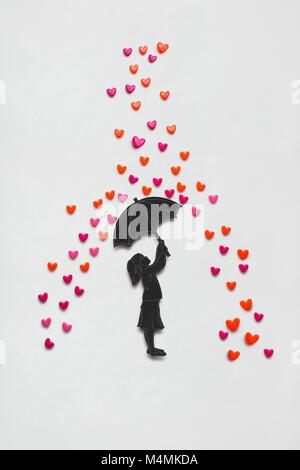 Kreative Valentines Konzept Foto von einem Mädchen mit Regenschirm und Regen Herzen auf weißem Hintergrund. - Stockfoto