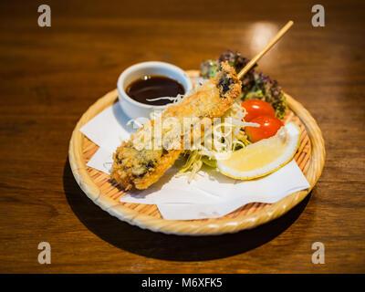 Frittierte Hokke Fisch am Spieß - Stockfoto