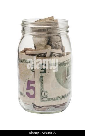 Ein Glas Spitze Glas mit amerikanischen fünf Dollar Scheine auf einem weißen Hintergrund gefüllt - Stockfoto