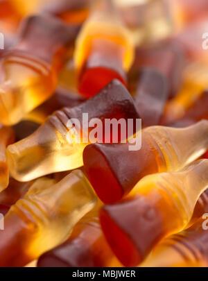 Ein Hintergrund der Cola Flavored Gummies - Stockfoto