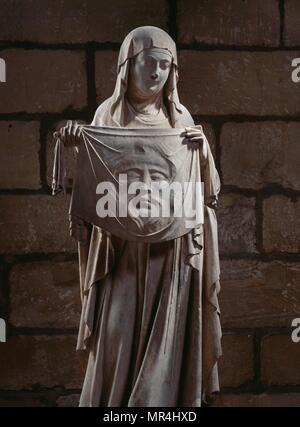 Statue des Heiligen Veronique Holding das Grabtuch Christi, mit seinem Gesicht in Relief eingeprägt. Norman Skulptur 1312. Kathedrale Notre Dame, Paris - Stockfoto