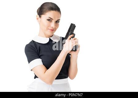 Junge Mädchen in Uniform holding Gun isoliert auf weißem - Stockfoto