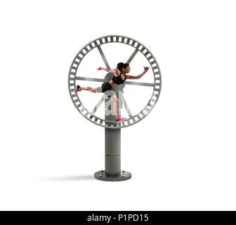 Athletische Frau läuft in einer Schleife Rad. Konzept der Sport Routine - Stockfoto