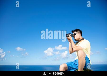 Mann, Foto von Ocean View auf der Rock - Stockfoto