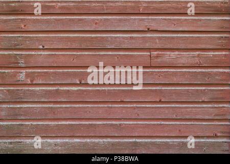 Full Frame Hintergrund einer alt und abgenutzt Holz board Wand rot lackiert - Stockfoto
