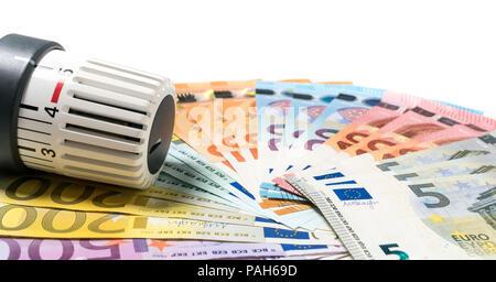 Heizung Thermostat mit Geld, teure Heizkosten Konzept. - Stockfoto