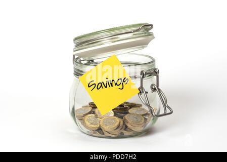 Schmiergeld: Glas Clip top Kilner storage Jar mit Britischen Pfund Münzen und stickie der Haftnotiz mit Word Einsparungen - Stockfoto