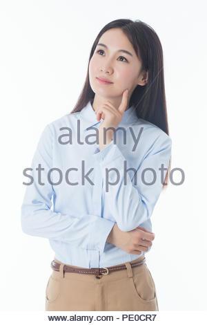 Junge Geschäftsfrau auf weißem Hintergrund isoliert lächelnd - Stockfoto