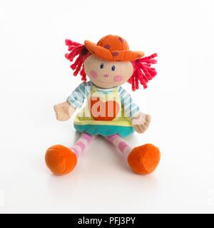 Bunte Puppe mit Herz aufgenäht, Vorderansicht - Stockfoto