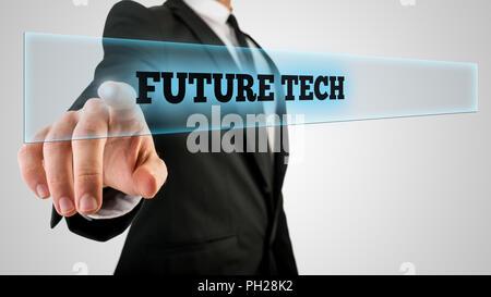 Konzeptionelle Geschäftsmann im schwarzen Anzug auf ein Glas mit einer leuchtenden Zukunft Tech Label, aufgenommen in der Nähe auf einem grauen Hintergrund. - Stockfoto
