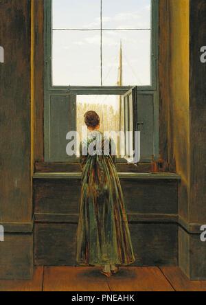Frau am Fenster die Frau am Fenster Femme à la Fenêtre Donna alla finestra. Datum/Zeit: 1822. Malerei. Öl auf Leinwand. 44 × 37 cm (17,3 x 14,5 in). Thema: Caspar David Friedrich. - Stockfoto