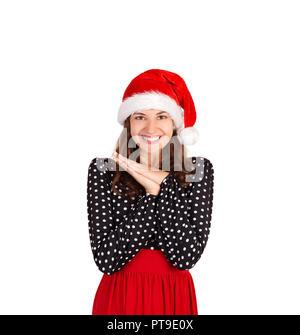 Zufrieden nd verträumte Frau freudig Lachen holding Palmen in der Nähe von Herz und und schaut von Glück und Freude. emotionale Mädchen in Santa Claus Weihnachten ha - Stockfoto