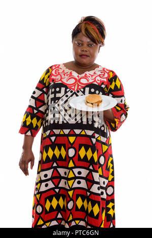 Studio Aufnahme von fetten schwarzen afrikanischen Frau, während sie bu - Stockfoto