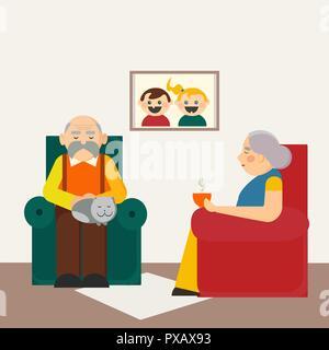 Nationale Großeltern-Tag. Großvater und Großmutter sitzen auf Stühlen. Älteres Ehepaar mit Katze zu Hause ausruhen. - Stockfoto