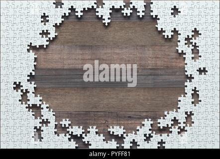 Leere Puzzle fehlt die Hälfte zu beenden. Begriff der Arbeit nicht abgeschlossen. - Stockfoto