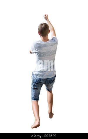 Hintere Ansicht in voller Länge Porträt von aktiven jungen Menschen ziehen etwas Imaginäres oder hängend halten mit Hand auf weißem Hintergrund. - Stockfoto