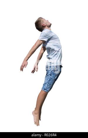 Seite View Full Length Portrait von Casual junger Mann springen Kostenlos über weißem Hintergrund. Freiheit Konzept Flying Boy. - Stockfoto