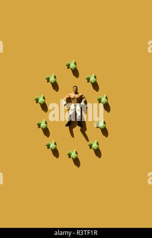 3D-Rendering, starken Mann mit grünem Herzen wrestler Hose und gefälschte Äpfel - Stockfoto