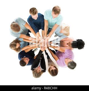 Creative Business Leute Stapeln Hände in Unordnung - Stockfoto