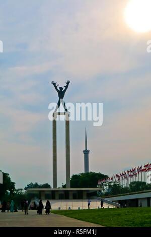 Eine Freiheit, die Statue an lapangan Banteng am Sunset moment - Stockfoto