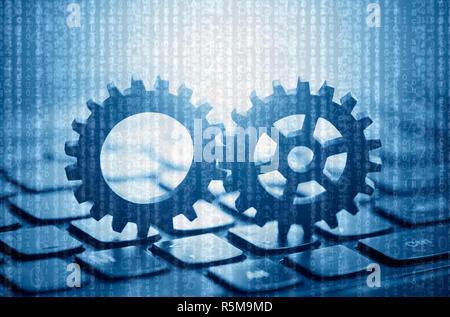 Zwei Gänge auf dem Computer Tastatur mit computer Code im Hintergrund - Stockfoto