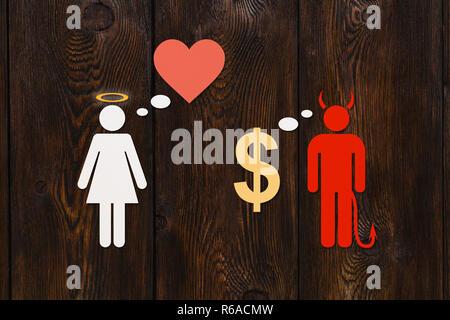 Papier, Paar, Liebe vs Geld Konzept. Teufel und Engel Frau. Abstrakte konzeptuelle Bild - Stockfoto