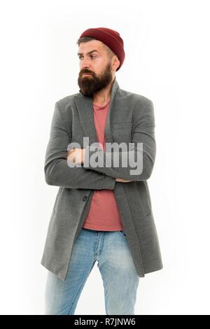 b9f819c0d168 Menswear und Fashion Concept. Man bärtige hipster Elegante modische Mantel  und Hut. Stylisches Outfit