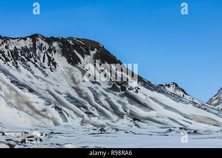 Endstation der Gletscher Ice Cave Tour zu einer Nocke der Gletscher Myrdalsjökull, die auf Katla Vulkan sitzt gesehen, im Winter in Island - Stockfoto