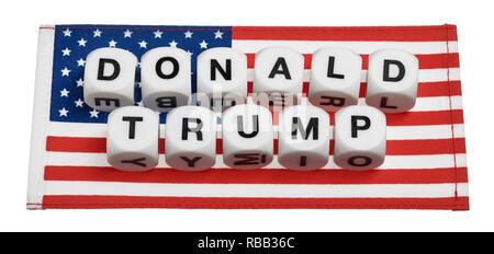 Die worte Donald Trump heraus auf eine amerikanische Flagge geschrieben - Stockfoto