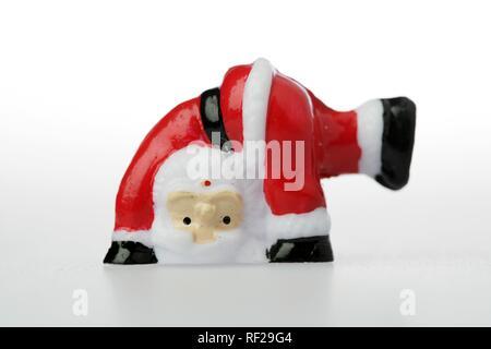 Kunststoff Santa Claus ein wagenrad - Stockfoto