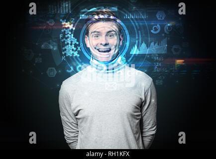 Gesichtserkennung System. Junger Mann auf dunklem Hintergrund, Gesichtserkennung Konzept - Stockfoto