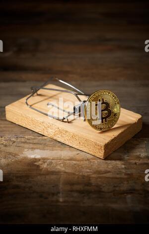 Bitcoin auf einer Mausefalle. - Stockfoto