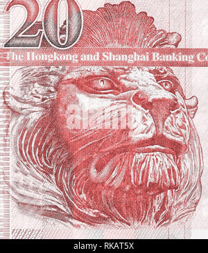 British Lion auf dem Fragment des alten 20 Hongkong Dollar Banknote close-up. Lebende Koralle Farbe getonte Bild - Stockfoto