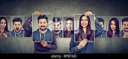 Ausgewogenes Verhältnis Konzept. Maskierte Mann und Frau zum Ausdruck bringen verschiedene Emotionen den Austausch von Gesichtern - Stockfoto
