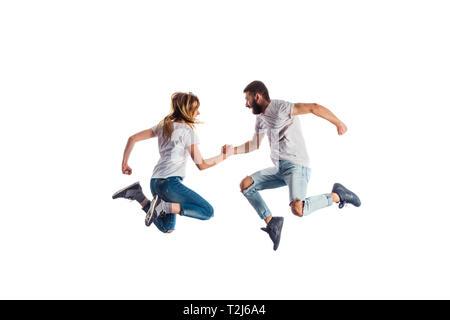 Zwei Leute haben Spaß beim Springen und Turnen - Stockfoto