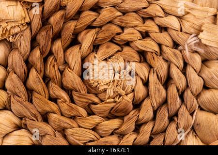 Abstrakte Textur eines Twisted brown Seil Makro Nahaufnahme Hintergrund im Nahbereich. - Stockfoto