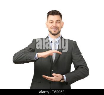 Junge Unternehmer halten etwas auf weißem Hintergrund - Stockfoto