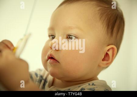 Nahaufnahme einer niedlichen Baby Gesicht - Stockfoto