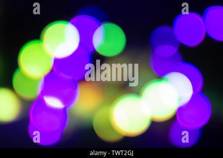 Duplex grün und lila blurry Neonlicht auf Schwarz. - Stockfoto