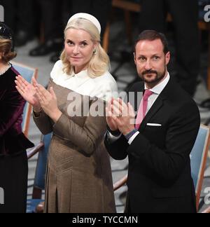 Norwegische Krone Prinzessin Mette- Marit und Kronprinz Haakon nehmen an der Friedensnobelpreis Zeremonie im Rathaus in Oslo am 10. Dezember 2018. Foto von Rune Hellestad/UPI - Stockfoto