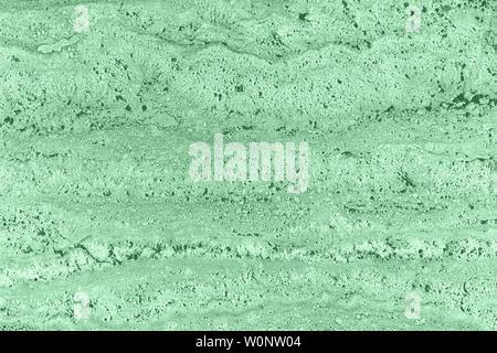 Nahaufnahme von Hellgrau und weiß porösen Stein texturierte Wand. Neutrale schwarzweiß Natur Hintergrund für Design und Skins. - Stockfoto