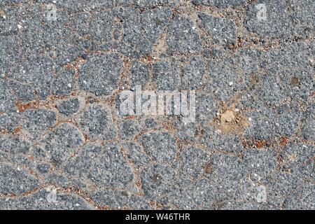 Detaillierte Nahaufnahme auf Asphalt Oberflächen von verschiedenen Straßen und Wege - Stockfoto